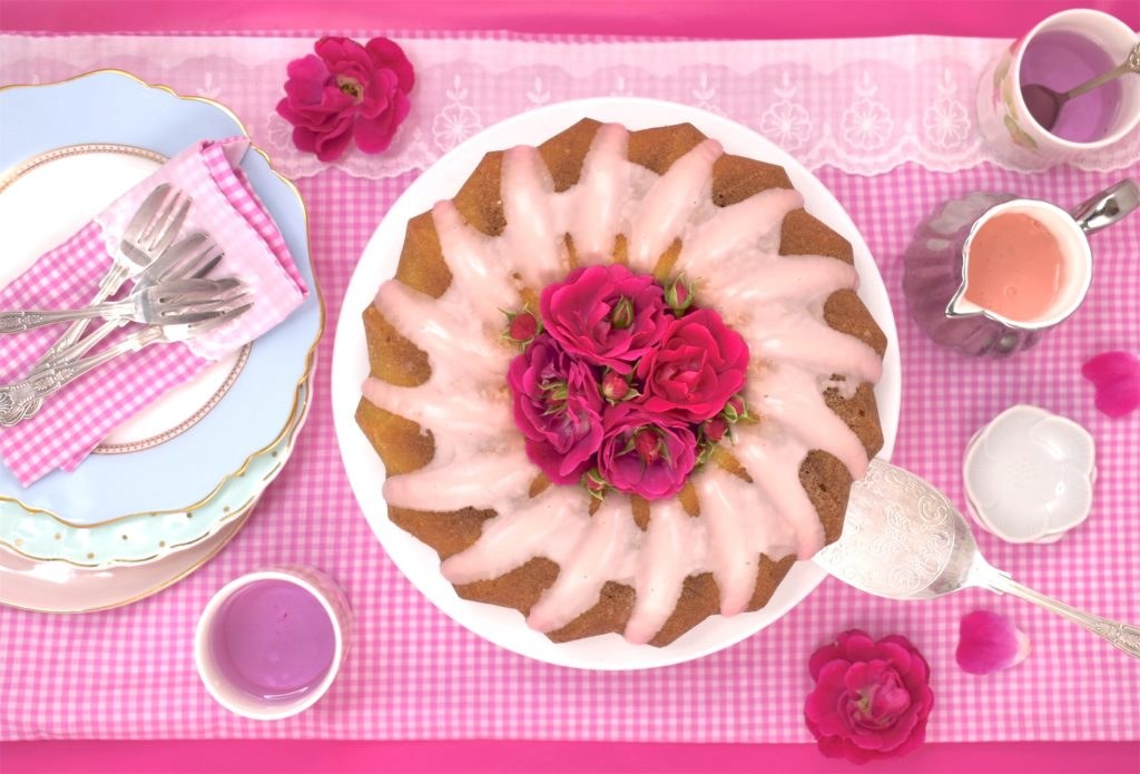 vegan coconut bundt cake with pink icing