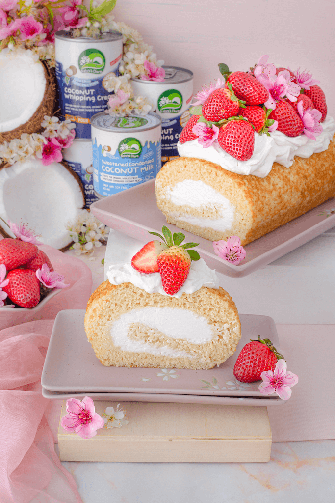 Vegan Coconut Roll Cake decorated with strawberries