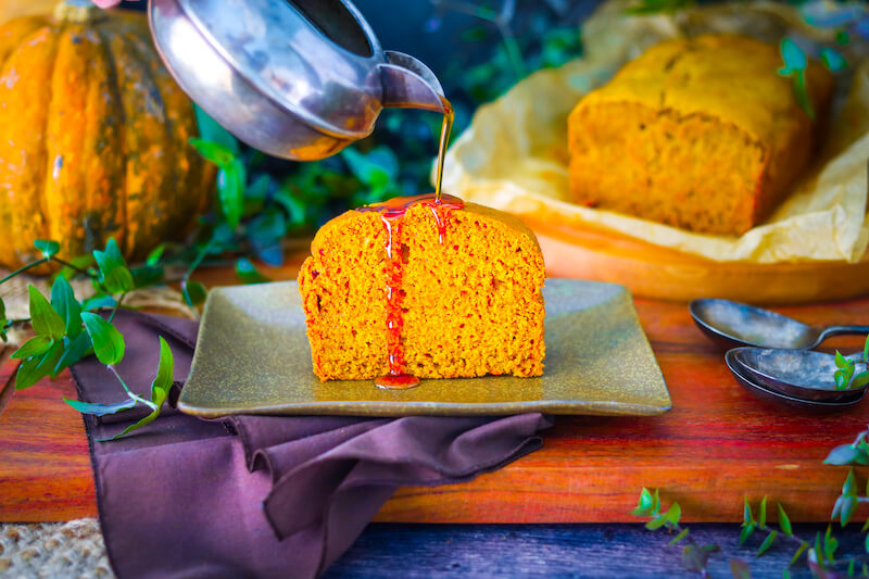 Vegan pumpkin bread slice with maple syrup